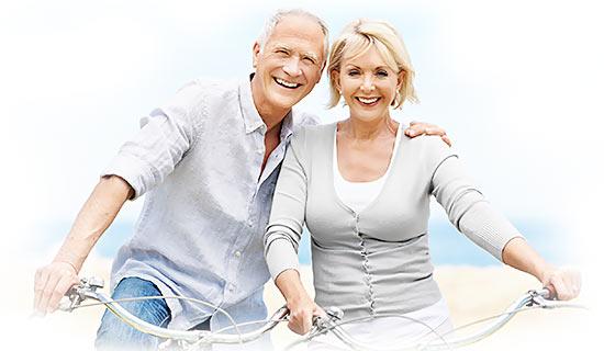 Happy Senior Couple Riding Bikes