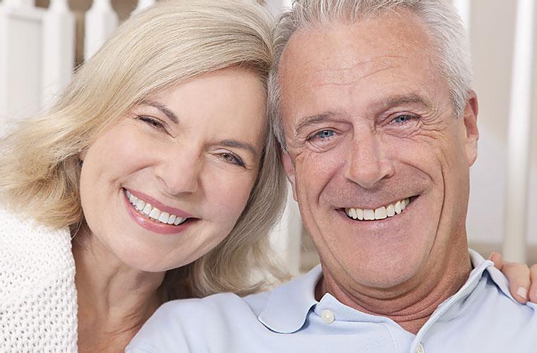 Senior Couple Smiling after Denture Treatment