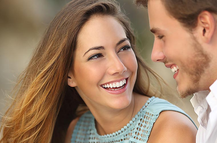 Young Couple smiling after cosmetic dentistry treatment